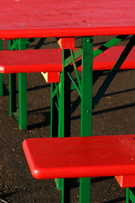 green legs on red table and benches